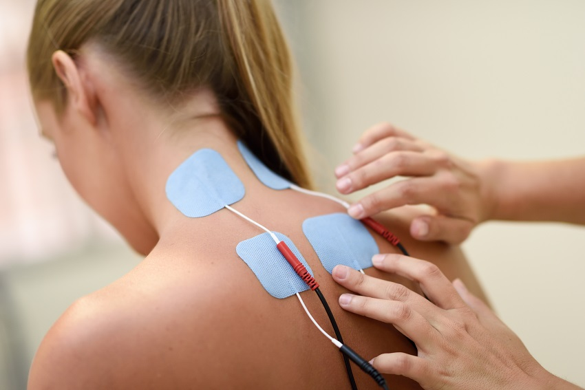 Electro stimulation in physical therapy to a young woman